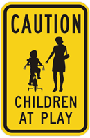 A caution sign that denotes a child-at-play area