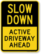 Active Driveway Ahead Slow Down Sign
