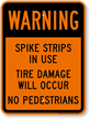 Spike Strips In Use Tire Damage Sign