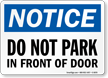 Don't Park In Front Of Door Sign