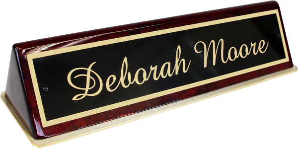 Brass plate and polished wood base makes this nameplate a favorite of lawyers, bankers and high-end offices.