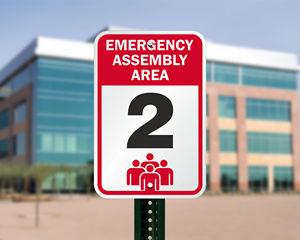 Outdoor emergency assembly area sign