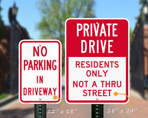 Two sizes of private driveway signs