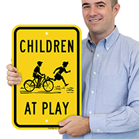 Children At Play with Graphic Sign