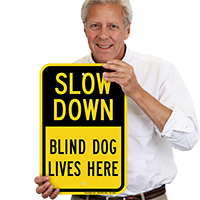 Slow Down Pets and Dogs at Play Sign