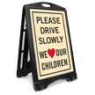 Drive Slowly We Love Our Children Sidewalk Sign