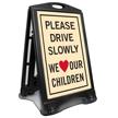 Drive Slowly We Love Our Children Sidewalk Sign