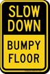 Slow Down Bumpy Floor Sign