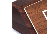 A plastic engraved nameplate is mounted elegantly onto a solid block of wood - order online.
